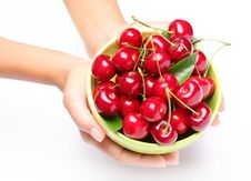 Free Crockery With Cherries In Woman Hands. Royalty Free Stock Image - 15552156