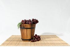 Grape In Wooden Basket Stock Photos