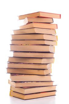 Free A Pile Of Battered Old Books On White Background Royalty Free Stock Photography - 15554527