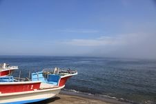 Free Fishing Boats On Shore On Clear Blue Sky Day Royalty Free Stock Photography - 15556107
