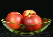 Three Large Ripe Nectarine In A Vase Stock Images