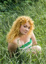 Free Young Red-haired Girl Sits In The Grass Royalty Free Stock Photo - 15567885