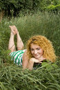 Free Young Red-haired Girl Lying In The Grass Stock Image - 15567931