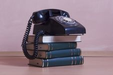 Free Stack Of Books With Vintage Telephone On Top Stock Photos - 15560383