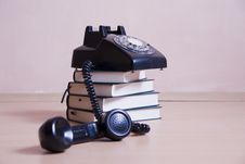 Free Stack Of Books With Vintage Telephone On Top Royalty Free Stock Photography - 15560427