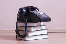 Free Stack Of Books With Vintage Telephone On Top Royalty Free Stock Photo - 15560435