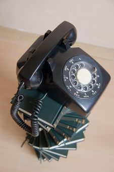 Free Stack Of Books With Vintage Telephone On Top Stock Images - 15560454
