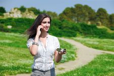 Free Pretty Woman Speaking On Phone With Compass Stock Image - 15561511