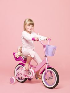 Free Girl On Her Bike Royalty Free Stock Photos - 15562608