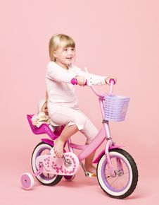 Free Girl On Her Bike Royalty Free Stock Image - 15562616