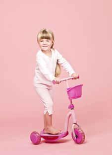 Young Girl With A Scooter Stock Photo