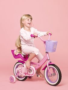 Free Girl On Her Bike Royalty Free Stock Photo - 15562645