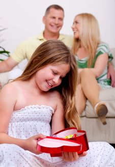 Free An Cute Girl Happy To See Her Christmas Gift Stock Photography - 15563002