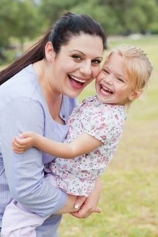 Free Curious Mother Carrying Her Daughter Stock Photo - 15563140