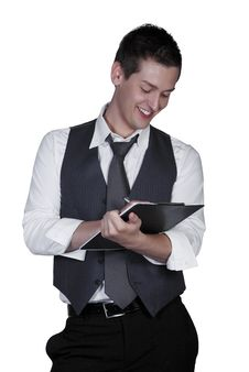 Free Young Man Writing On Clipboard, Studio Sho Stock Photo - 15564750