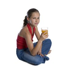 Young Girl Sitting With Glass Of Orange Juice Royalty Free Stock Photo