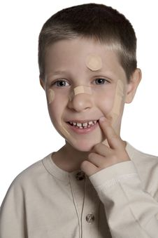 Free Young Boy With Band Aids On Face, Studio Shot Stock Image - 15564781