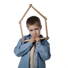 Free Young Sad Boy Holding House-shaped Measuring Tape Royalty Free Stock Image - 15564846