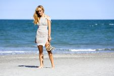 Free Attractive Woman Standing Barefoot At Beach Royalty Free Stock Image - 15564866
