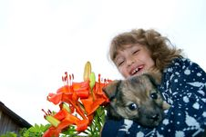 Free The Girl Holds A Puppy Royalty Free Stock Photo - 15567425
