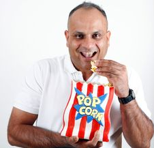 Office Worker Eating Popcorn Royalty Free Stock Photos