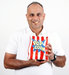 Office Worker Eating Popcorn Stock Photo