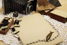 Free Empty Sheet, Retro Camera And Antique Domino Stock Image - 15568821