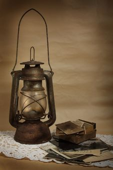 Free Old Kerosene Lamp And Photos Royalty Free Stock Photography - 15568887