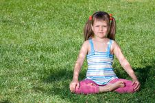 Free Little Girl Sits In The Shade In Asana On Grass Royalty Free Stock Photo - 15569125