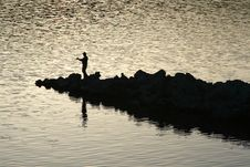 Free Fishing In The Sunset Royalty Free Stock Image - 15569886