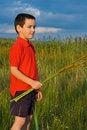 Free Boy Holding Reeds Stock Photos - 15572493