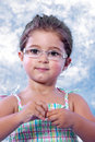 Free Beautiful Little Girl Unwrapping A Candy Royalty Free Stock Images - 15579259