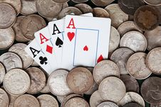 Free Four Aces And Stacks Of Silver Dollars Stock Photo - 15571050