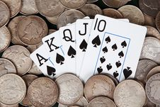 Free Royal Flush And Stacks Of Silver Dollars Royalty Free Stock Images - 15571139