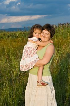 Little Girl And Her Mother Staying Outside Stock Image