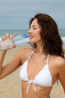 Free Closeup Of Woman Drinking From Water Royalty Free Stock Images - 15573339
