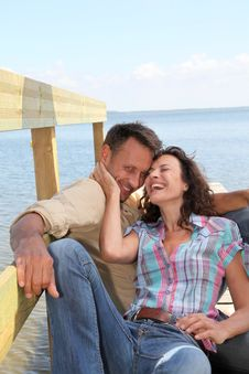 Free Couple Laughing On A Pontoon Stock Images - 15573364