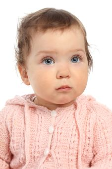 Cute Little Baby In A Pink Jumper Looks Up Royalty Free Stock Photography
