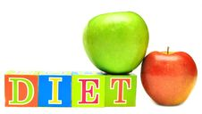 Green And Red Apple And Cubes With Letters - Diet Stock Photo