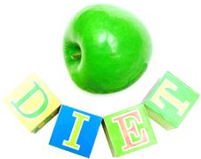 Green Apple And Cubes With Letters - Diet Royalty Free Stock Image