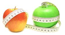 Tape Measure Wrapped Around Green And Red Apple Stock Photo