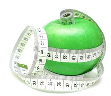 Tape Measure Wrapped Around Green Apple Royalty Free Stock Images