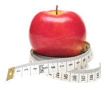Free Tape Measure Wrapped Around Red Apple Royalty Free Stock Photography - 15574747