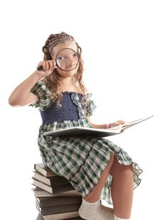 Little Girl Looking Through Magnifying Glass Stock Images