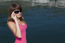 Female At Sea Background In Sunglasses Royalty Free Stock Photos