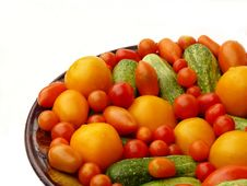 Free Fresh Tomatoes And Cucumbers On A Plate. Stock Image - 15579251
