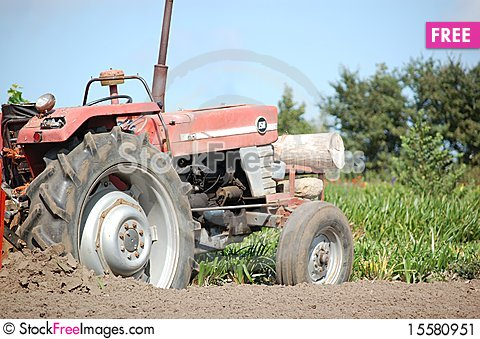 Free Old Tractor At Work Stock Image - 15580951