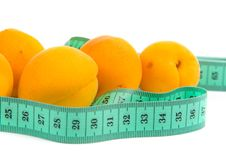 Free Ripe Apricots And Measuring Tape Royalty Free Stock Image - 15581036