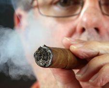 Free Close Focus On A Man Smoking A Cigar Stock Photo - 15581750