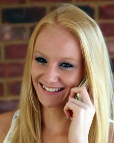 Free Young Female Talking On Cell Phone Royalty Free Stock Image - 15581846